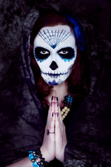 Woman witch with scary makeup.Dia de los muertos