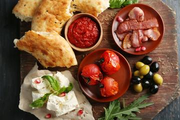 Ingredients of Mediterranean cuisine, on wooden board, close-up