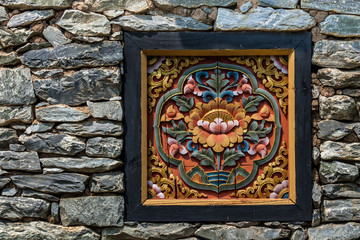 Chinese wooden window decorated inside with stone wall.