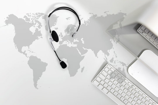 contact global concept , top view desk with headset, computer and map
