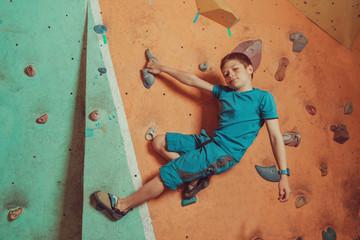Climber boy training in gym