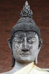 Close-up head of old buddha statue in Thailand