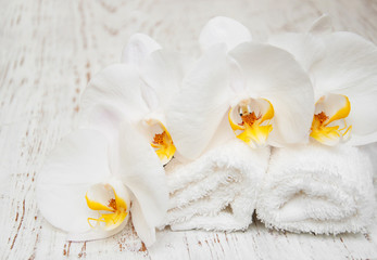 White orchids and towels
