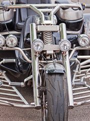 Chrome display on one of the motorcycles parked  at a bike rally UK