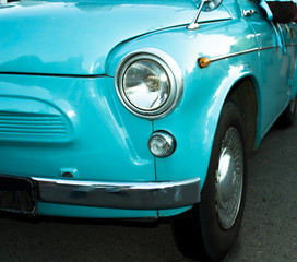 Turquoise retro car close up view