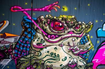 Graffiti: Frosch bei der Jagd