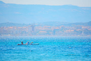 couple kayaking in Alghero coastline