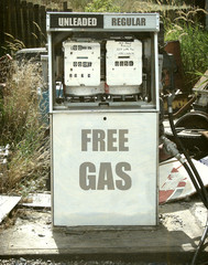 aged and worn vintage photo of retro gas pump offering free gas