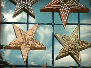 aged and worn vintage photo of neon sign stars
