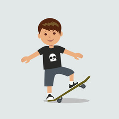 A young boy performs a trick on a skateboard