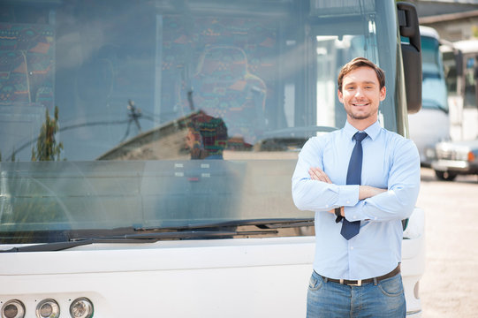 Attractive young driver is having rest outside