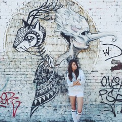 girl in white on the graffiti background