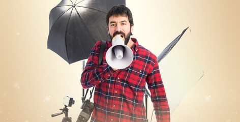 Photographer shouting by megaphone
