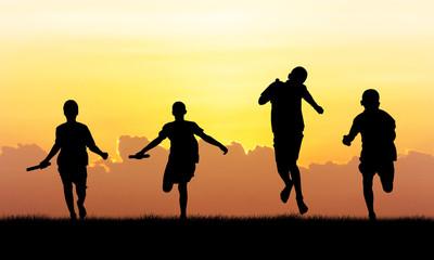 athlete  running   at sunset background