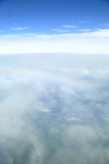 Rainbow which suits cloud roundly. Japan seen from the sky.