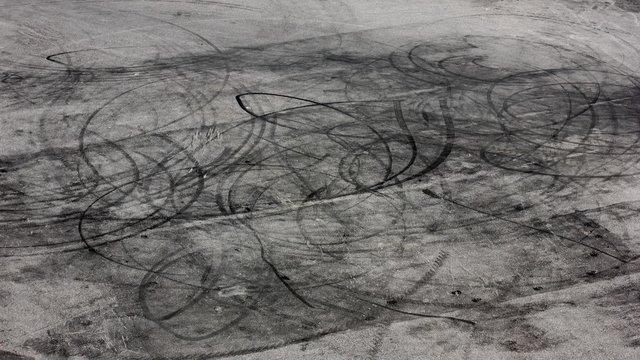 Drifting. Traces of wheels at asphalt.