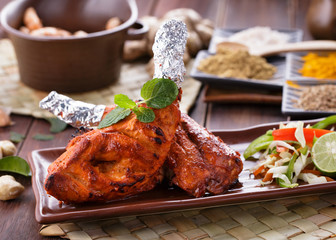 indian tandoori chicken garnished
