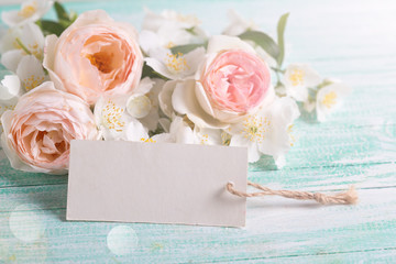Roses, jasmine flowers and empty tag