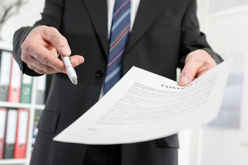Businessman submitting a contract