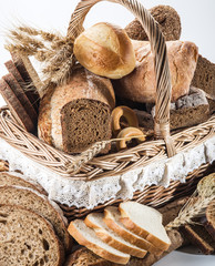 Different types of bread in the basket.