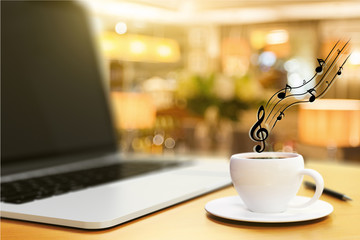 cup of coffee, laptop and musical notes, concept