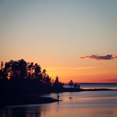 Lonesome fisherman on the bank. Ladoga lake.