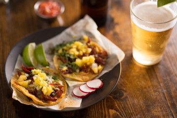 Sticker - authentic street tacos and beer on plate with copy space