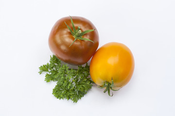 Tomato and parsley isolated on white