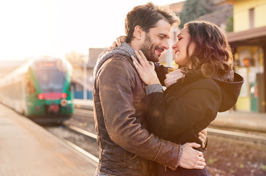 Loving couple at train station