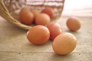 hen eggs on the wood desk