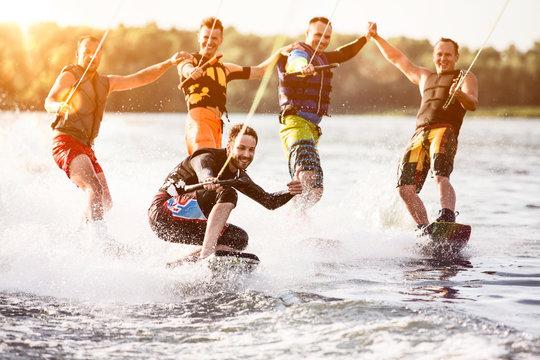 Five wake bord riders having fun