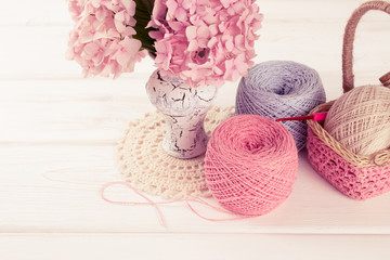 Yarn for crochet and  basket for handmade on white wooden boards