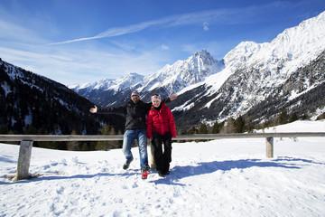 Happy couple having fun in winter landscape