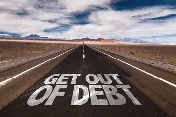 Get Out of Debt written on desert road Wall mural