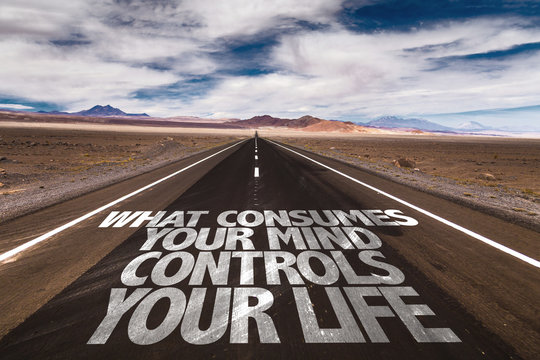 What Consumes Your Mind Controls You Life written on the road