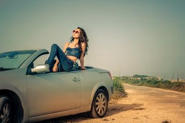 Beautiful girl sitting in a car