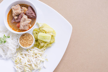soft focus Rice noodles with spicy pork sauce