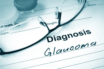 Diagnosis list with Glaucoma and glasses. Eye disorder concept.
