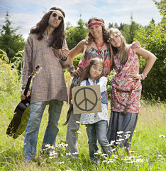 """Hippie family with """"Pacific"""" sign"""