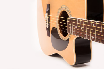 Electric acoustic yellow guitar close up isolated on white background