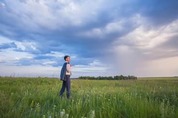 Portrait of businessman on a green meadow