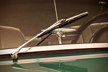 Retro styled image of the screen wiper of a classic car