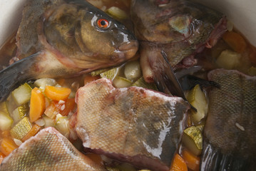 Pieces of raw tench in a pan