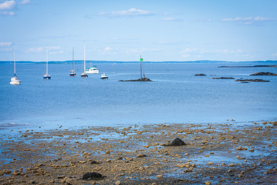 beautiful ocean shore with boats in the water in Biddeford