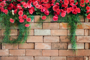 Wall Mural - flowers on the brick wall