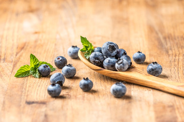 fresh blueberry on a wooden table and spoon