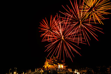 Ho kham luang northern thai style building in Royal Flora temple (ratchaphreuk)in Chiang Mai,Thailand.Firework.