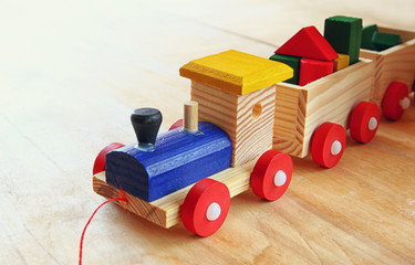 close up of Wooden toy train over wooden table. selective focus.
