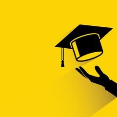 hand holding graduation cap