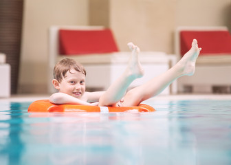 Swiming boy in pool